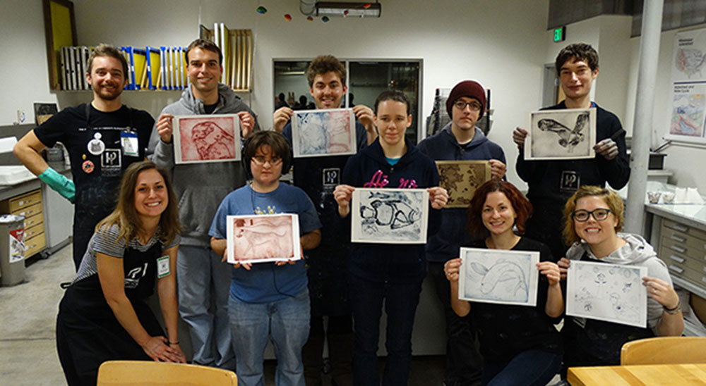 Students from Minnesota Life College holding their artwork.