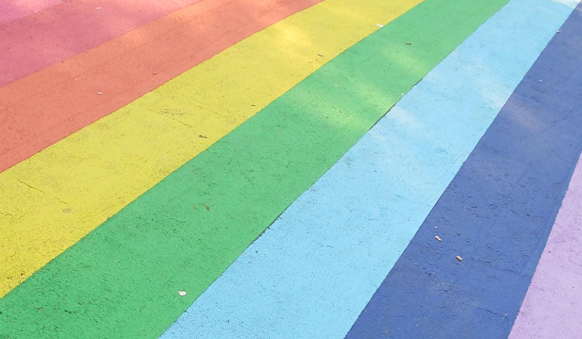 painted stripes on pavement in colors of rainbow