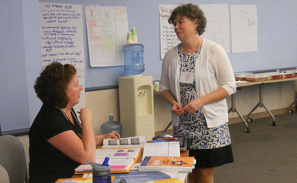 SIG co-director Maureen Hawes speaks with colleague Arlene Russell Bender.