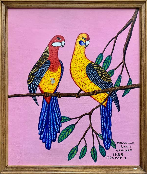 Two colorfully painted birds sit on a branch, both looking in the same direction. Their tail feathers are bright blue, their head, necks, and breasts are a yellow and red, and the background of the painting is pink. Another tree branch, with green leaves, appears to rest behind the birds.