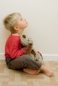 a little boy holding a stuffed bear