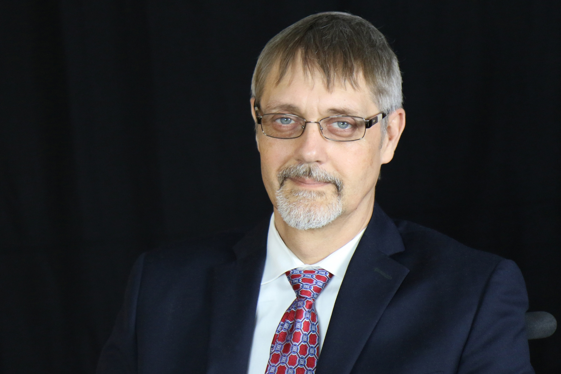 Photograph of John Tschida, who is Acting Executive Director of AUCD and one of the authors of this article.