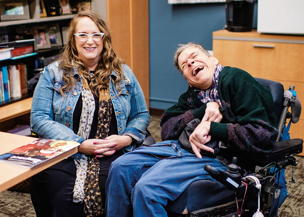 ICI Director Amy Hewitt (left) and Coordinator John Smith (right) share a laugh in her office.