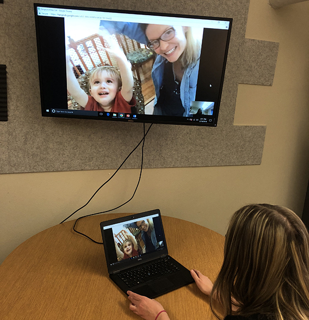 Jessica Simacek (on screen with her son) demonstrates ICI's Telehealth Laboratory.