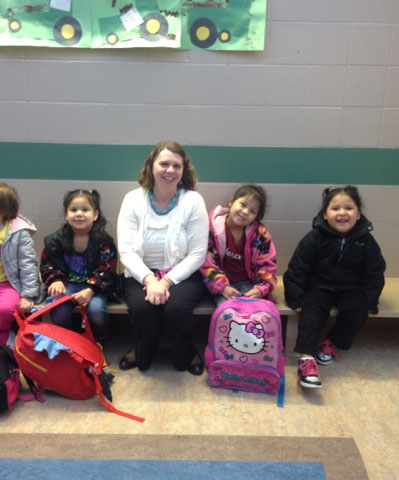 photo of Tammy Wicksrom in a classromm with children